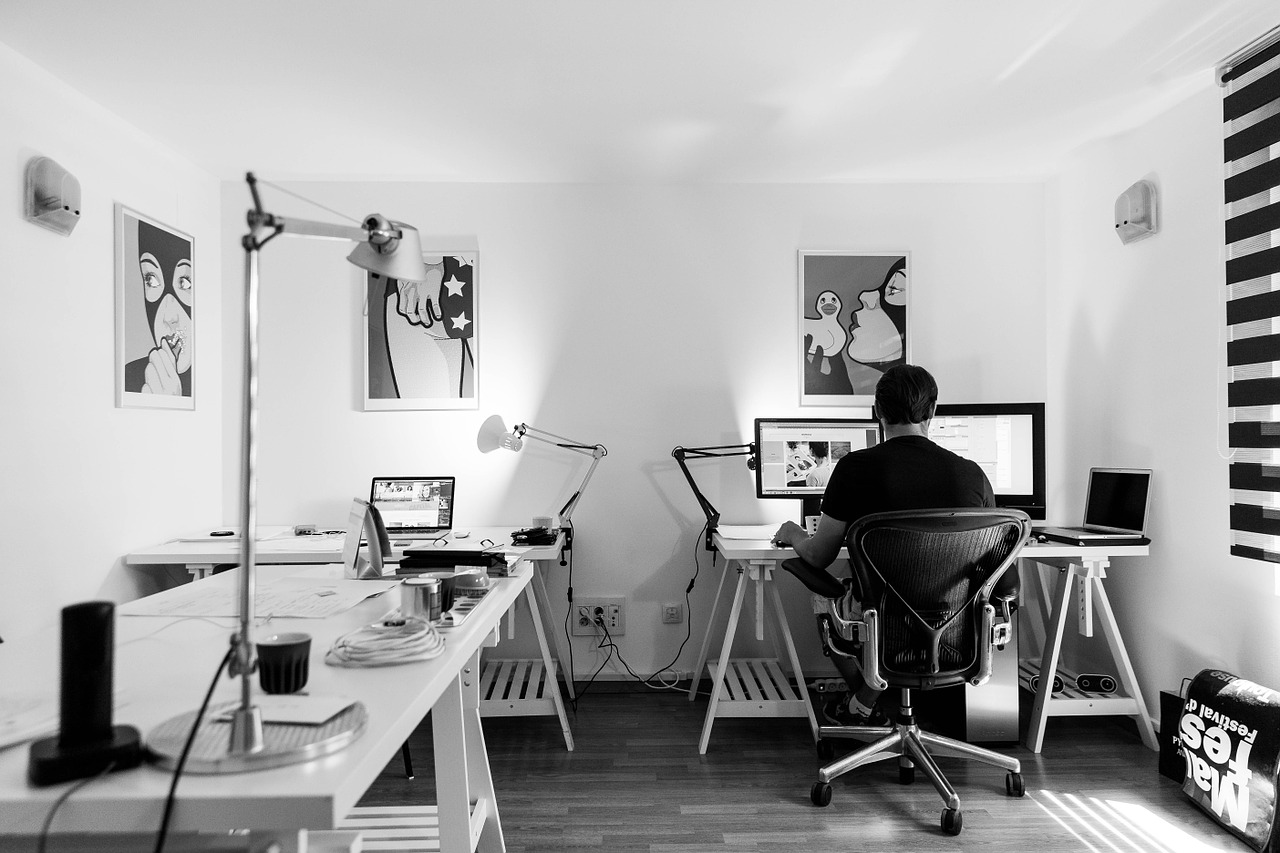a person sitting on a desk in an indoor office setup